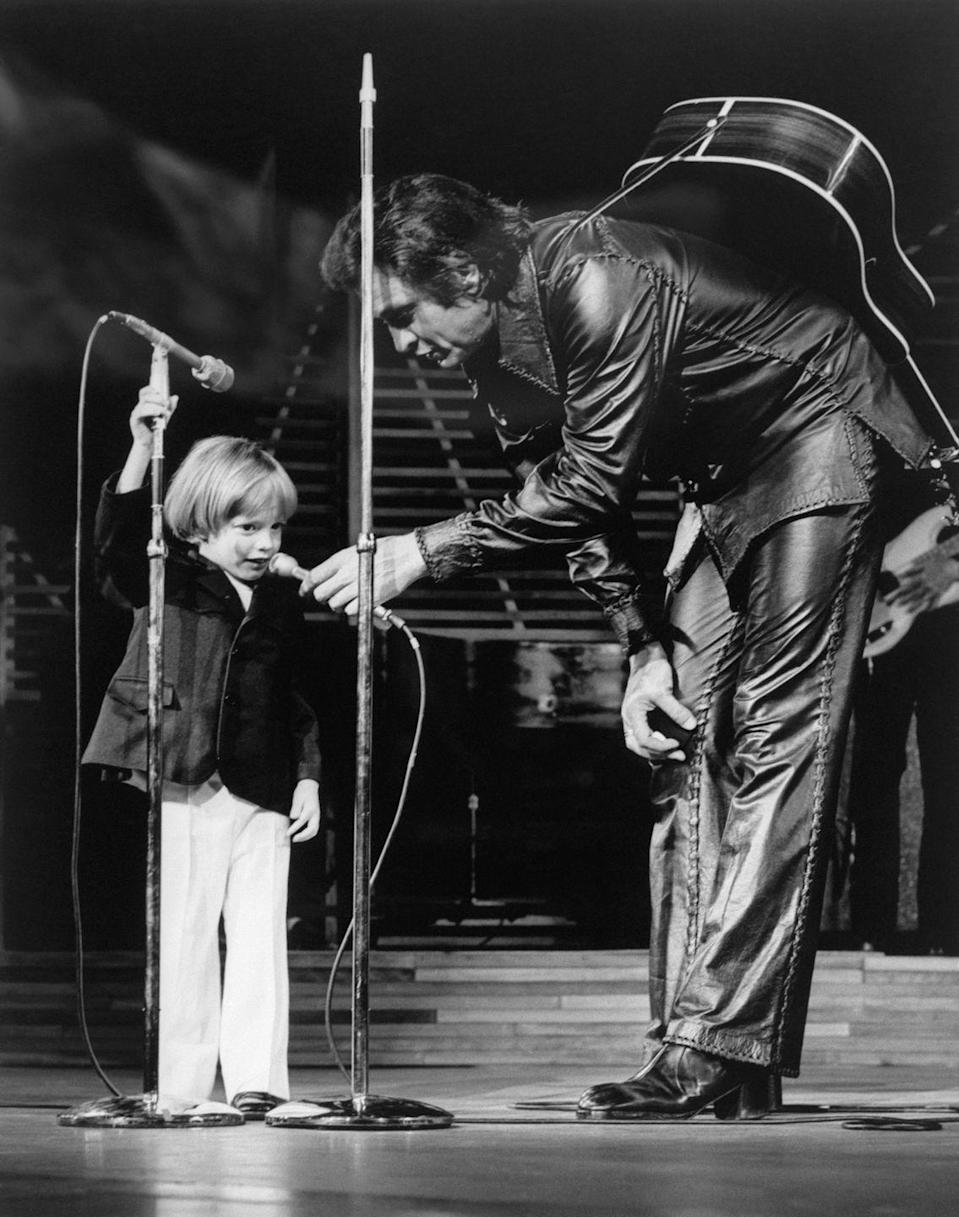 """<p>Johnny Cash gives his son John Carter Cash the microphone to sing """"Mary Had a Little Lamb"""" in 1973. He was 3, and the youngest person to make a Las Vegas nightclub appearance.</p>"""