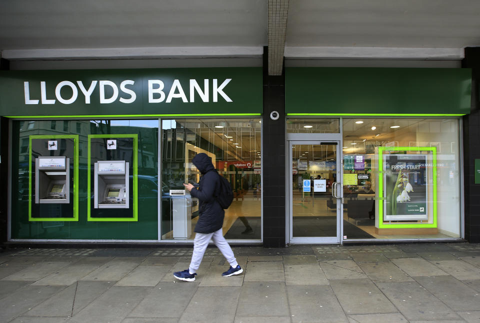 A man walks past a Lloyds Bank branch in central London, Britain February 25, 2016. Lloyds Banking Group rewarded investors with a surprise 2 billion pound payout on Thursday, underlying its intent to be the biggest dividend payer among Britain's banks and its recovery after a state bailout.  REUTERS/Paul Hackett