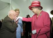 Actor Mickey Rooney kisses the hand of Britain's Queen Elizabeth during a garden party celebrating her state visit to the U.S. at the British Embassy in Washington in this May 7, 2007 file photo. Rooney, the pint-sized screen dynamo of the 1930s and 1940s best known for his boy-next-door role in the Andy Hardy movies, died on April 6, 2014 at 93, the TMZ celebrity website reported. It did not give a cause of death and a spokesman was not immediately available for comment. REUTERS/Jonathan Ernst/Files (UNITED STATES - Tags: ROYALS ENTERTAINMENT OBITUARY)