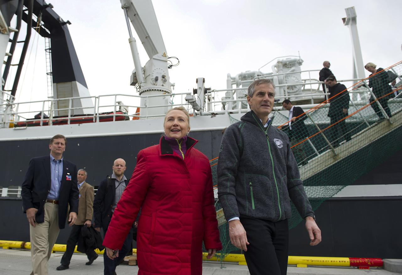 US Secretary of State Hillary Rodham Clinton and Norway's Minister of Foreign Affairs Jonas Gahr Stoere, right, walk on the dock after taking a boat tour on the Arctic Research vessel Helmer Hanssen on a fjord, near the northern Norwegian city of Tromso, Norway, Saturday June 2, 2012. Clinton is trekking north of the Arctic Circle, a region that could become a new international battleground for resources. (AP Photo/Saul Loeb, Pool)