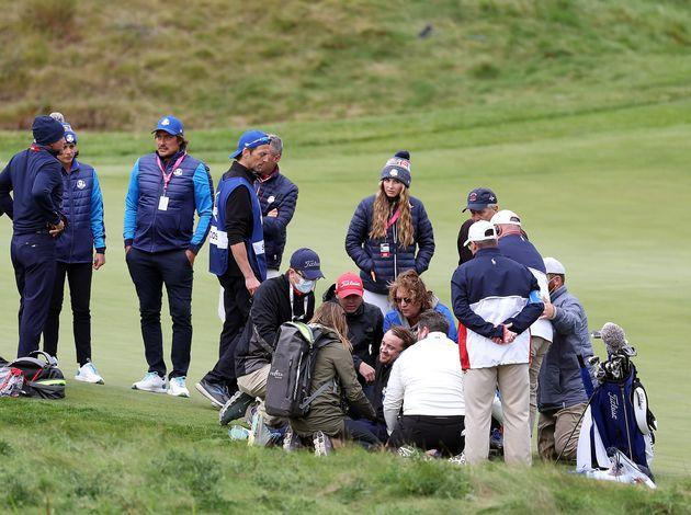 People surround Tom Felton after he collapsed during the celebrity golf matches ahead of the 43rd Ryder Cup at the Whistling Straits course in Wisconsin. (Photo: Richard Heathcote via Getty Images)