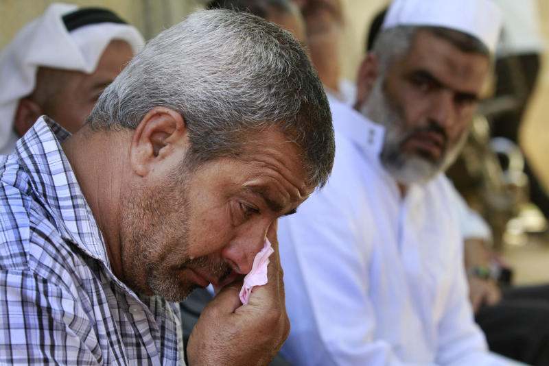 The father of Ahmed Abu Nasr, no name given, cries at his home in Khan Younis Refugee Camp, Friday, June 1, 2012. Abu Nasr and an Israeli soldier were killed in a shootout near the border with the Gaza Strip early Friday, the Israeli military said. The exchange of fire began after the militant crossed the fence separating the Hamas-run coastal strip and southern Israel. (AP photo/Hatem Moussa)