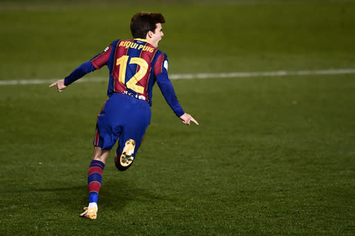 Barcelona's Riqui Puig celebrates after scoring the winning goal during the Spanish Super Cup semi final soccer match between Barcelona and Real Sociedad at Nuevo Arcangel stadium in Cordoba, Spain, Wednesday, Jan. 13, 2021. Barcelona will play the final after defeating Real Sociedad 3-2 in a penalty shootout after the game ended 1-1. (AP Photo/Francisco Seco)