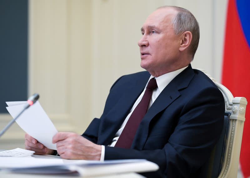 FILE PHOTO: Russian President Vladimir Putin takes part in a virtual conference in Moscow