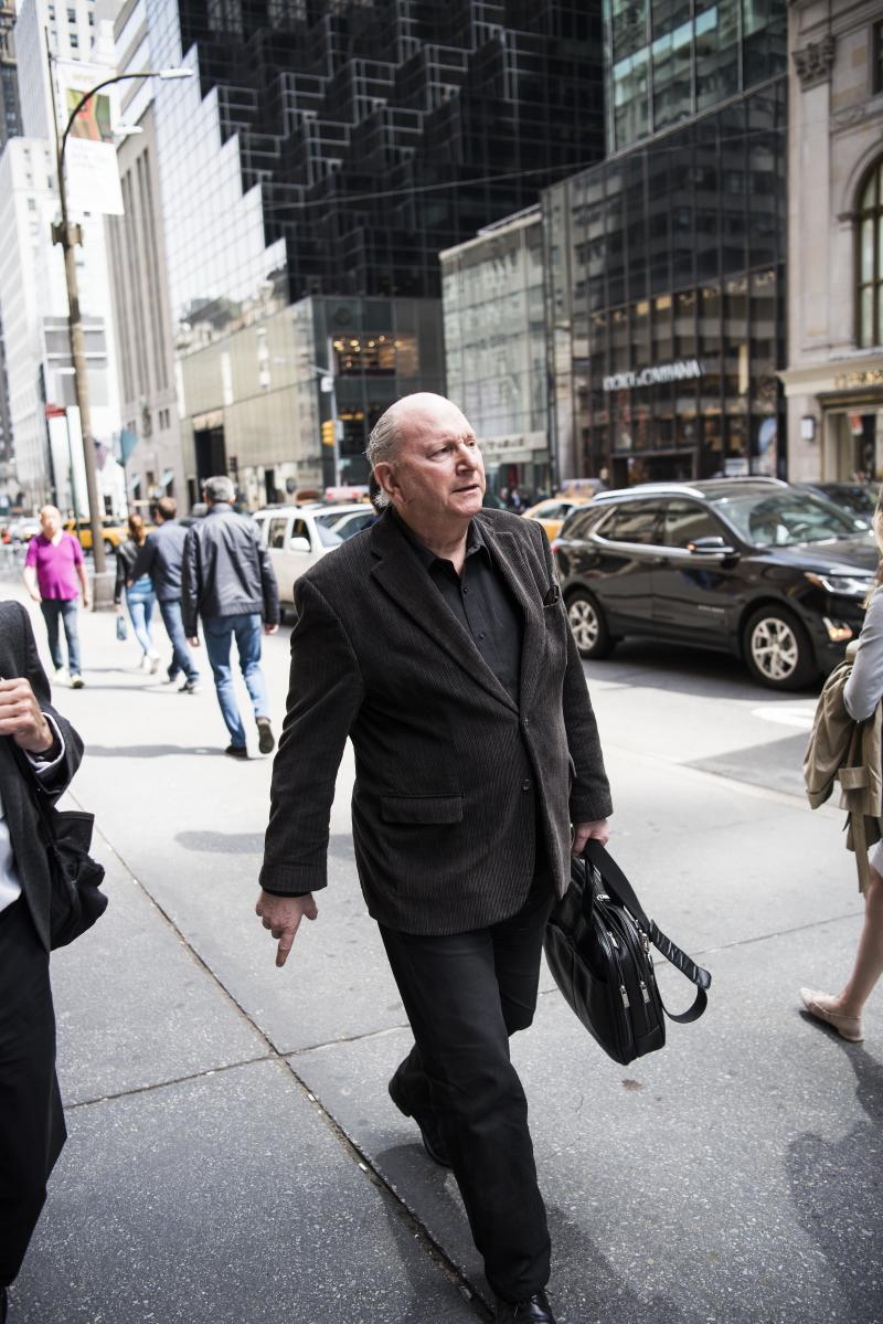 Jerome Rose walks along Fifth Avenue in Manhattan. He has moved to a ground-floor apartment after a fire in his previous building killed four people in 1989. (Damon Dahlen/HuffPost)