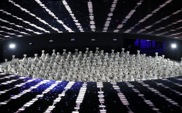 <p>Performers take part in the opening ceremony. REUTERS/Stefano Rellandini </p>