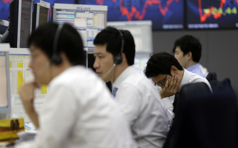 Asia stocks fall after Spain gets downgrade