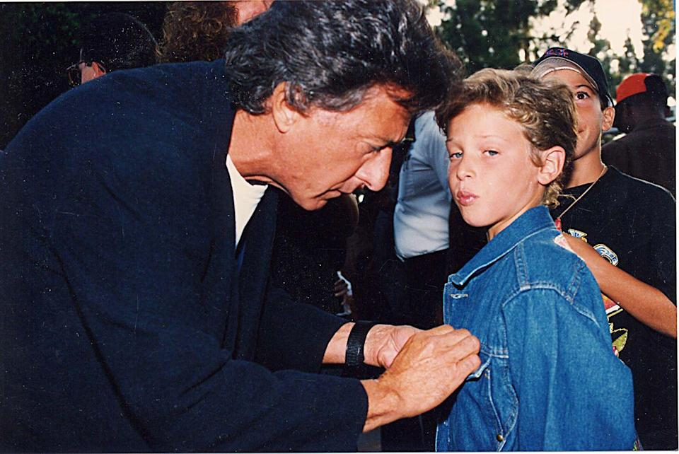 <p>Dustin Hoffman fixes his son Jake's denim jacket before they walk the red carpet of the MTV Video Music Awards in 1992. </p>