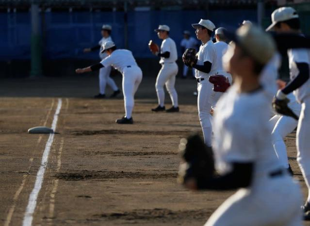 Members of Fukushima Commercial High School baseball team take part in a workout at the school's baseball field in Fukushima, Japan