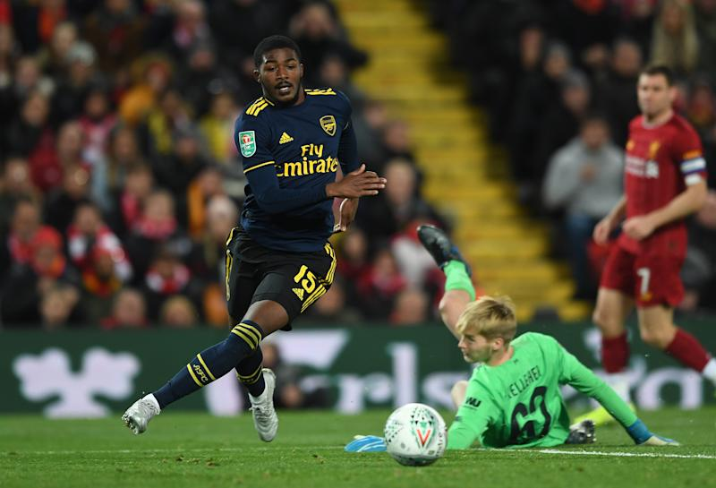 LIVERPOOL, ENGLAND - OCTOBER 30: Ainsley Maitland-Niles rounds Caoimhin Kelleher of Liverpool on his way to scoring Arsenal's 4th goal during the Carabao Cup Round of 16 match between Liverpool and Arsenal at Anfield on October 30, 2019 in Liverpool, England. (Photo by David Price/Arsenal FC via Getty Images)