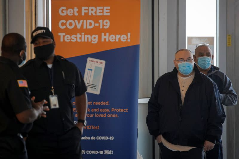 People stand in line to be tested the coronavirus disease (COVID-19), at a test center at the Staten Island Ferry Terminal in Staten Island, New York