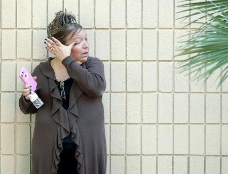 A woman weeps at the Rudy Hernandez Community Center as she waits for a relative who was not injured after a shooting rampage at the Inland Regional Center in San Bernardino, December 2, 2015. REUTERS/Alex Gallardo