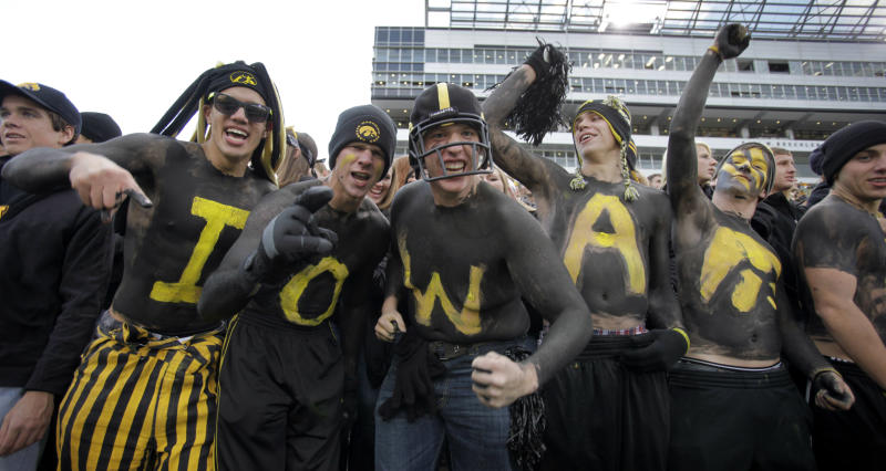 FILE - In this Oct. 2, 2010, file photo University of Iowa students react before an NCAA college football game against Penn State in Iowa City, Iowa. The Princeton Review named the University of Iowa as the nations's best party school Monday, Aug. 5, 2013, on a list determined by 126,000 students in a nationwide survey. (AP Photo/Charlie Neibergall, File)