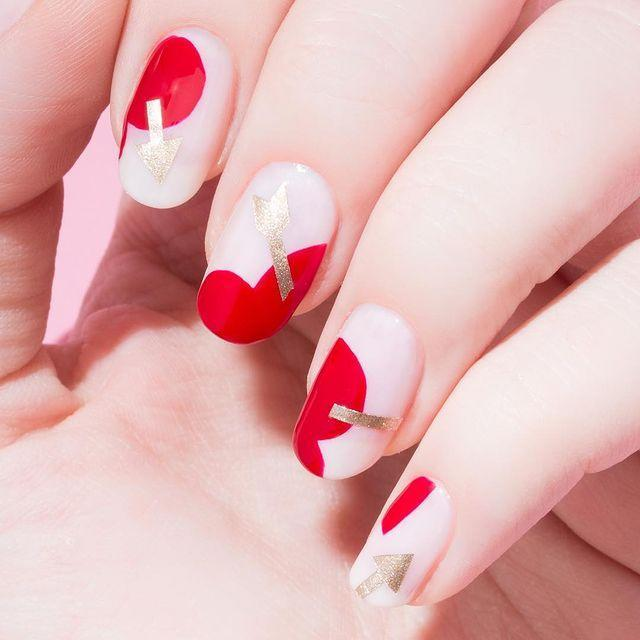 """<p>Take an expected motif, like a golden arrow through a heart, and trace it on nails in an oversized design for an unexpected twist.</p><p><a href=""""https://www.instagram.com/p/BtWgQivFgTl/"""" rel=""""nofollow noopener"""" target=""""_blank"""" data-ylk=""""slk:See the original post on Instagram"""" class=""""link rapid-noclick-resp"""">See the original post on Instagram</a></p>"""