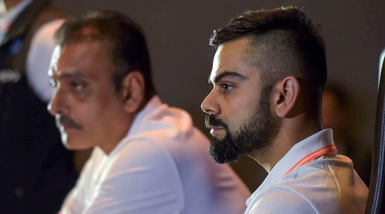 Indian cricket captain Virat Kohli (R) and head coach Ravi Shastri during a press conference ahead of the team's departure for England and Ireland, in New Delhi