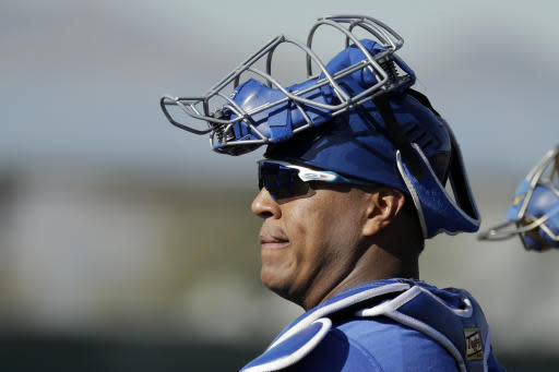 Kansas City Royals catcher Salvador Perez waits to start a drill during spring training baseball practice Wednesday, Feb. 12, 2020, in Surprise, Ariz. (AP Photo/Charlie Riedel)