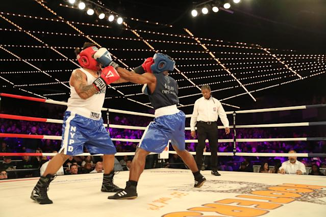 <p>John Chalen (red) battles Reshawn Merrick (blue) in the Bronx Precinct Callout during the NYPD Boxing Championships at the Hulu Theater at Madison Square Garden on March 15, 2018. (Gordon Donovan/Yahoo News) </p>