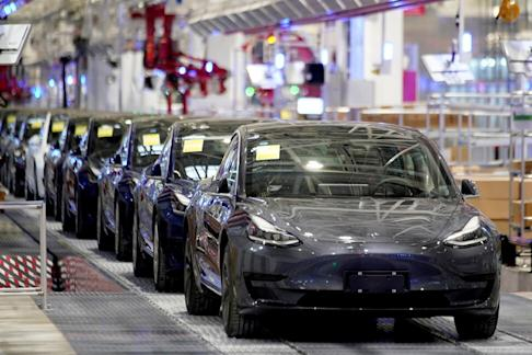 Tesla's China-made Model 3 vehicles are seen during a delivery event at its factory in Shanghai on January 7, 2020. Photo: Reuters