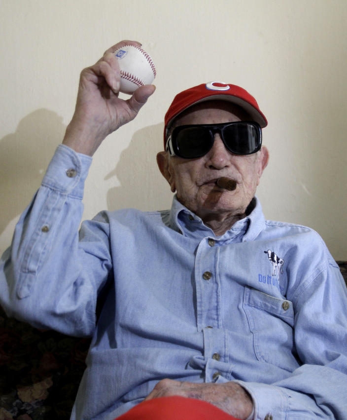 FILE - In this April 25, 2012 file photo, Conrado Marrero holds up a baseball as he poses for pictures during an interview in Havana, Cuba. Family members say Conrado Marrero, the oldest living former Major League Baseball player, has died in Havana. He was 102, just two days short of his 103rd birthday. Grandson Rogelio Marrero confirmed the death Wednesday afternoon, April 23, 2014. (AP Photo/Franklin Reyes, File)