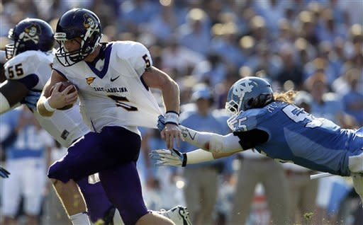 North Carolina's Tommy Heffernan (55) reaches for East Carolina quarterback Shane Carden (5) during the first half of an NCAA college football game in Chapel Hill, N.C., Saturday, Sept. 22, 2012. (AP Photo/Gerry Broome)