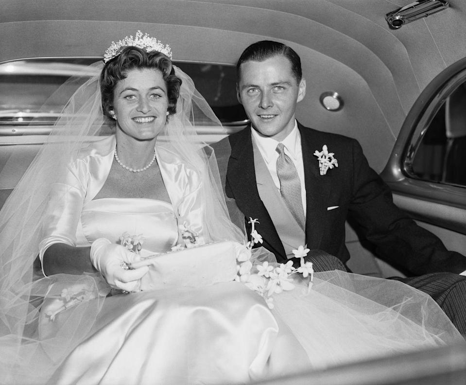 <p>On her wedding day, Jean posed for a photo in the car with her husband, Stephen Smith.</p>