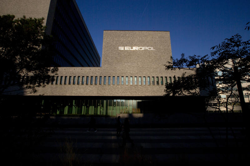 FILE- This Wednesday, Oct. 10, 2018, file photo shows the sun bouncing off the Europol headquarters in The Hague, Netherlands. The European Union police agency says that cybercriminals are using new technology and exploiting existing online vulnerabilities as they shift their focus to larger and more profitable targets. (AP Photo/Peter Dejong, File)