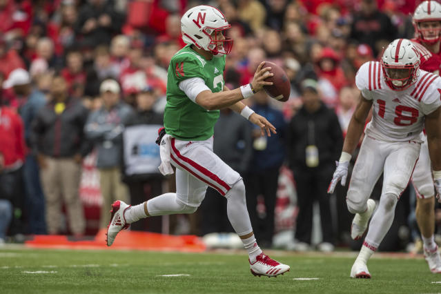 Nebraska Red team quarterback Adrian Martinez (2) runs the ball for a touchdown against the Nebraska White team linebacker Jacob Weinmaster (57) during the second quarter of the Red/White game in Lincoln, Neb., Saturday, April 21, 2018. (AP Photo/John Peterson)