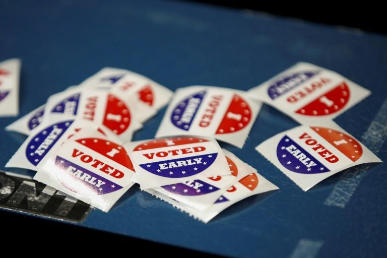 """I Voted Early"" stickers are seen at Tippecanoe Library on the first day of in-person early voting for the November 3, 2020 elections in Milwaukee, Wisconsin"
