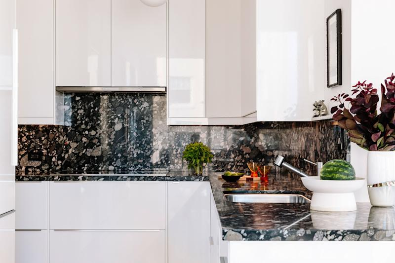 In the kitchen, the couple paired Marinace black granite counter tops with IKEA high-gloss cabinets.
