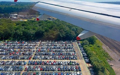 Aerial view of airport car parking seen from passenger jet decending towards Gatwick London - Credit: Media Mogul