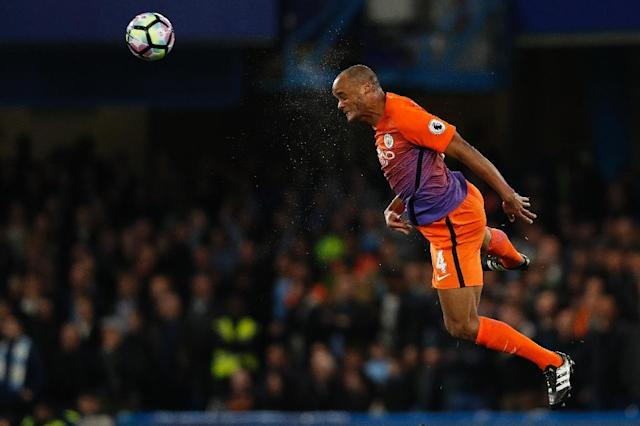 Manchester City's defender Vincent Kompany heads the ball during the English Premier League football match between Chelsea and Manchester City at Stamford Bridge in London on April 5, 2017 (AFP Photo/Adrian DENNIS)