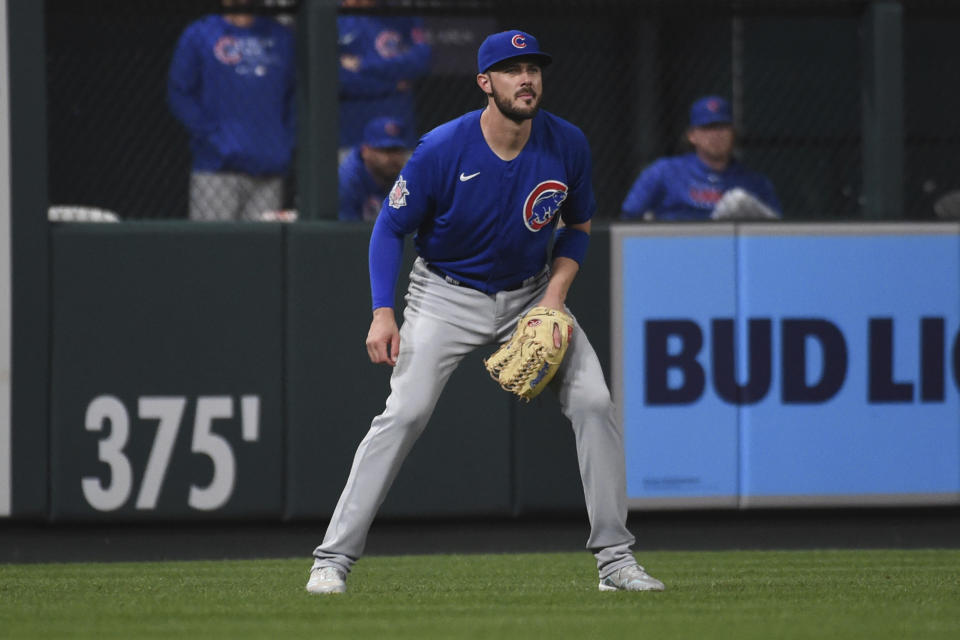 Chicago Cubs left fielder Kris Bryant takes up his position during the seventh inning of a baseball game against the St. Louis Cardinals Monday, July 19, 2021, in St. Louis. (AP Photo/Joe Puetz)