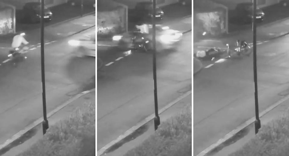 A cyclist is seen on CCTV in England being hit by a car.