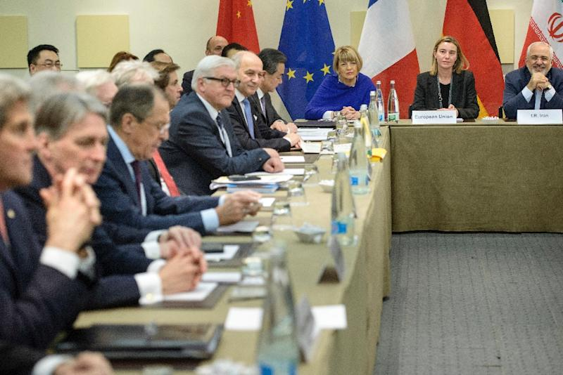 (R-L) Iranian Foreign Minister Javad Zarif, EU High Representative Federica Mogherini and EU Political Director Helga Schmid with foreign ministers before the start of the P5+1 meeting at the Beau Rivage Palace Hotel in Lausanne on March 30, 2015 (AFP Photo/Brendan Smialowski)