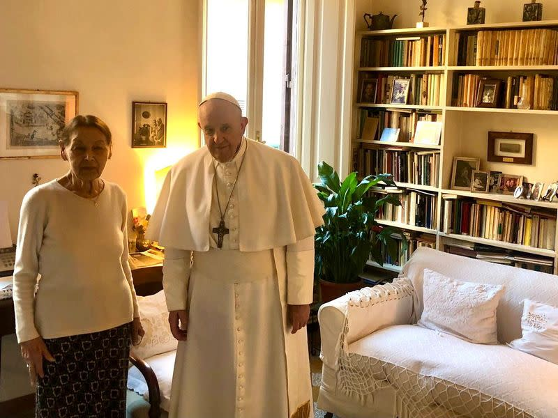 Pope Francis and poetess and Holocaust survivor, Edith Brick, pose for photographs in Rome