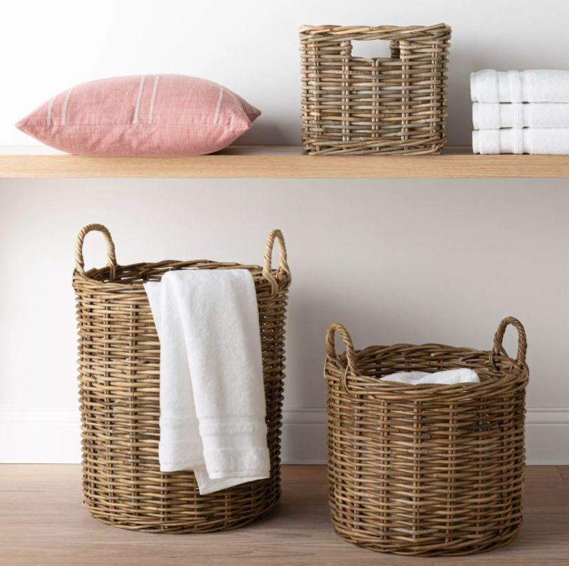 """With this basket, you can store away extra blankets, towels and toys to declutter around the house. The rattan makes this basket a bit bohemian, too. <a href=""""https://goto.target.com/c/2055067/81938/2092?u=https%3A%2F%2Fwww.target.com%2Fp%2Fdecorative-round-kooboo-rattan-basket-16-34-x-14-34-gray-threshold-8482-designed-with-studio-mcgee%2F-%2FA-78169125%3Fref%3Dtgt_adv_XS000000%26AFID%3Dgoogle_pla_df%26fndsrc%3Dtgtao%26DFA%3D71700000012577541%26CPNG%3DPLA_Home%252BDecor%252BShopping%26adgroup%3DSC_Home%252BDecor%26LID%3D700000001170770pgs%26LNM%3DPRODUCT_GROUP%26network%3Dg%26device%3Dc%26location%3D9004054%26targetid%3Dpla-797847081118%26ds_rl%3D1246978%26ds_rl%3D1247068%26ds_rl%3D1248099%26gclid%3DCj0KCQjw8rT8BRCbARIsALWiOvRDA3KqebdMuClNct_uEcKKpx1d5yEVk1qyKSEqz-4dZ5R5IAIedLwaAqI8EALw_wcB%26gclsrc%3Daw.ds&subid1=5&subid2=cottagecore&subid3=decor"""" target=""""_blank"""" rel=""""noopener noreferrer"""">Find it starting at $40 at Target</a>."""