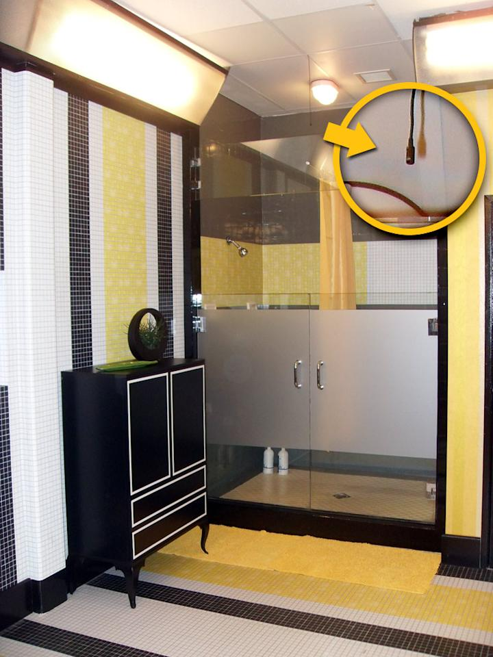 Naturally, the public bathroom features very little privacy. Not only does the shower feature skimpy, frosted glass panels, it also comes with a mini microphone prepared to pick up any soapy conversations.