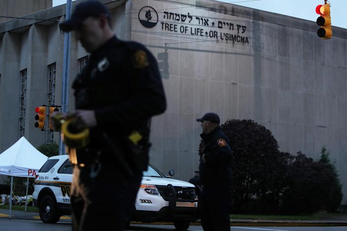 Police guard the Tree of Life synagogue after Saturday's shooting. (Photo: Cathal McNaughton/Reuters)