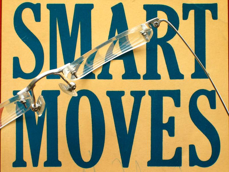 The words smart moves are printed, and on top of them is a pair of glasses.