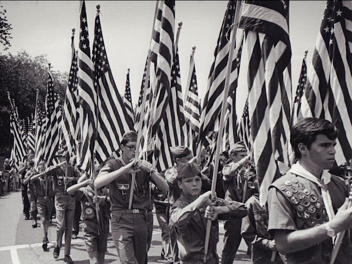 Boy Scouts of America carrying American flags, July 4, 1970.