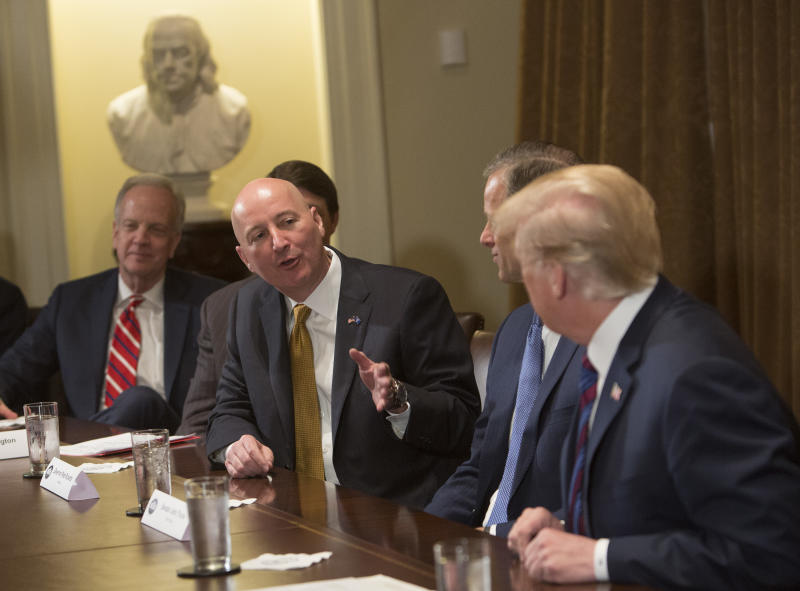 WASHINGTON, DC - APRIL 12: (AFP OUT) Nebraska Governor Pete Ricketts speaks to U.S. President Donald Trump during a meeting on trade with governors and members of Congress at the White House on April 12, 2018 in Washington, DC. (Photo by Chris Kleponis - Pool/Getty Images)
