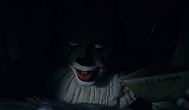 Pennywise lurks in the sewers in new IT trailer - Credit: Warner Bros.