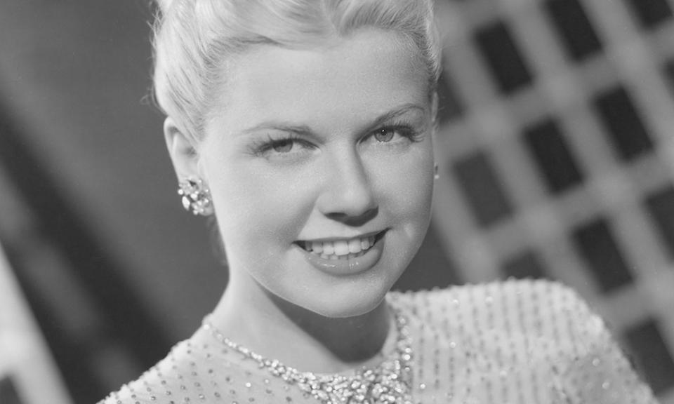 """The Hollywood legend <a href=""""https://uk.movies.yahoo.com/hollywood-icon-doris-day-has-died-aged-97-131433501.html"""" data-ylk=""""slk:died aged 97;outcm:mb_qualified_link;_E:mb_qualified_link;ct:story;"""" class=""""link rapid-noclick-resp yahoo-link"""">died aged 97</a> on 13 May after contracting """"a serious case of pneumonia"""". She starred in films <em>Calamity Jane</em> and <em>Pillow Talk</em> and was well known for her 1956 hit Que Sera, Sera, which she performed in <em>The Man Who Knew Too Much</em>. Day left acting behind in the 70s to focus on her animal foundation. (Photo by NBCU Photo Bank)"""