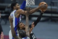 Cleveland Cavaliers' Darius Garland (10) drives to the basket as Detroit Pistons' Josh Jackson (20) knocks the ball loose in the first half of an NBA basketball game, Wednesday, Jan. 27, 2021, in Cleveland. (AP Photo/Tony Dejak)