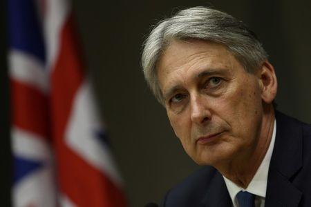 Chancellor of the Exchequer Hammond attends a meeting in Brasilia