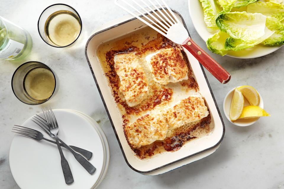 """We kind of wanted to spend this year wrapped in a blanket of creamy roasted garlic and cheese, just like this fish. <a href=""""https://www.epicurious.com/recipes/food/views/roasted-garlic-and-parmesan-baked-halibut?mbid=synd_yahoo_rss"""" rel=""""nofollow noopener"""" target=""""_blank"""" data-ylk=""""slk:See recipe."""" class=""""link rapid-noclick-resp"""">See recipe.</a>"""