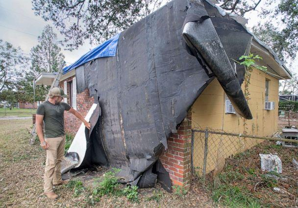 PHOTO: Benjamin Elkins shows the damage to his roof at his West Detroit Boulevard home caused by Hurricane Zeta, in the Ensley area of Pensacola, Fla. Oct. 27, 2020.  (Gregg Pachkowski/Imagn via USA today Network)