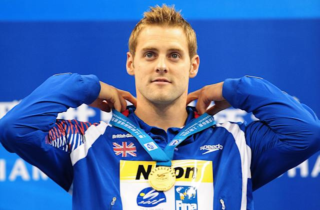 Britain's Liam Tancock adjusts his gold medal around his neck on the podium during the award ceremony for final of the men's 50-metre backstroke swimming event in the FINA World Championships at the indoor stadium of the Oriental Sports Center in Shanghai on July 31, 2011. AFP PHOTO / MARK RALSTON (Photo credit should read MARK RALSTON/AFP/Getty Images)