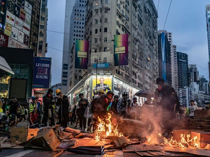 Pro-democracy protesters set barricade on fire at a demonstration in Causeway Bay district on October 6, 2019 in Hong Kong, China.