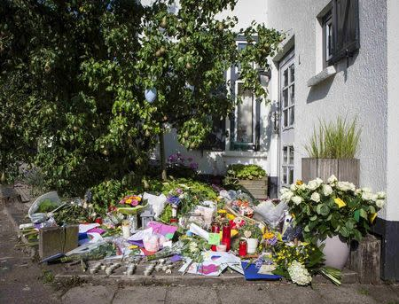 Flowers are laid in front of the house of a family who were all killed in Thursday's Malaysia Airlines Boeing 777 plane crash, in Neerkant, near Eindhoven July 19, 2014. REUTERS/Mischa Rapmund